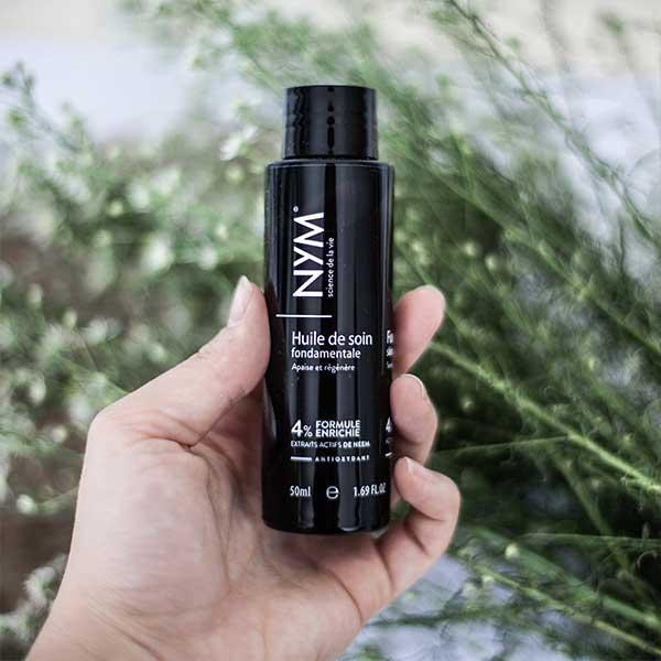 flacon main huile de soin noire NYM 50ml