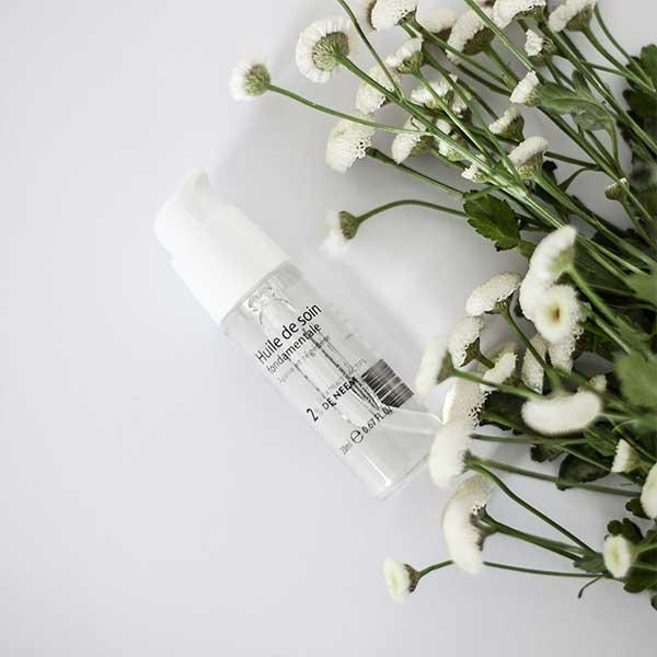 Huile de soin fondamentale 2% 20ml NYM avec des fleurs